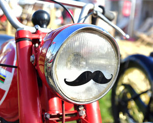 CM25 5237 Motorcycle headlamp with a moustache